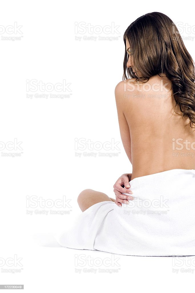Nude women wrapped in a white towel royalty-free stock photo