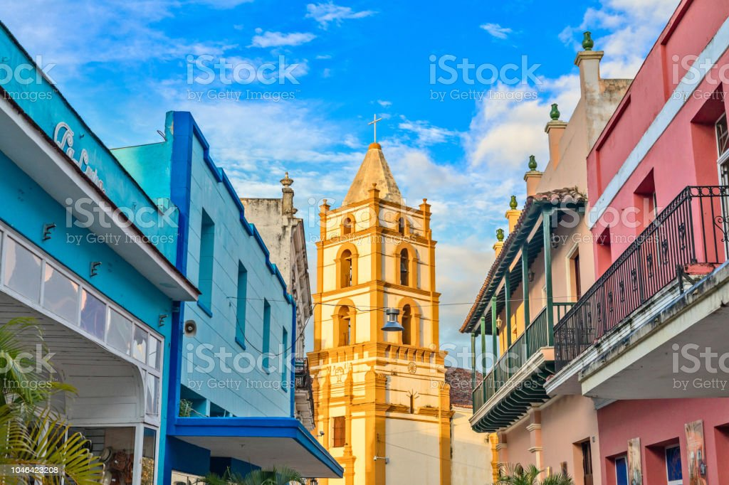 Nuestra Senora de la Soledad church and Spanish colonial colorful Nuestra Senora de la Soledad church and Spanish colonial colorful decorated houses with balconies, in the center of Camaguey, Cuba Architecture Stock Photo