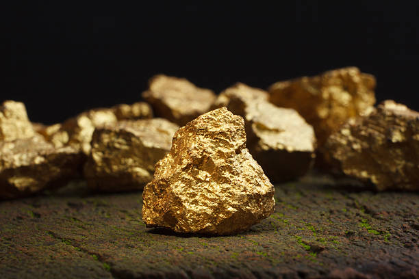 nugget gold - bumpy stock pictures, royalty-free photos & images