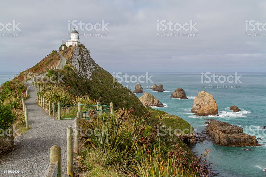 Nugget Point with lighthouse. stock photo