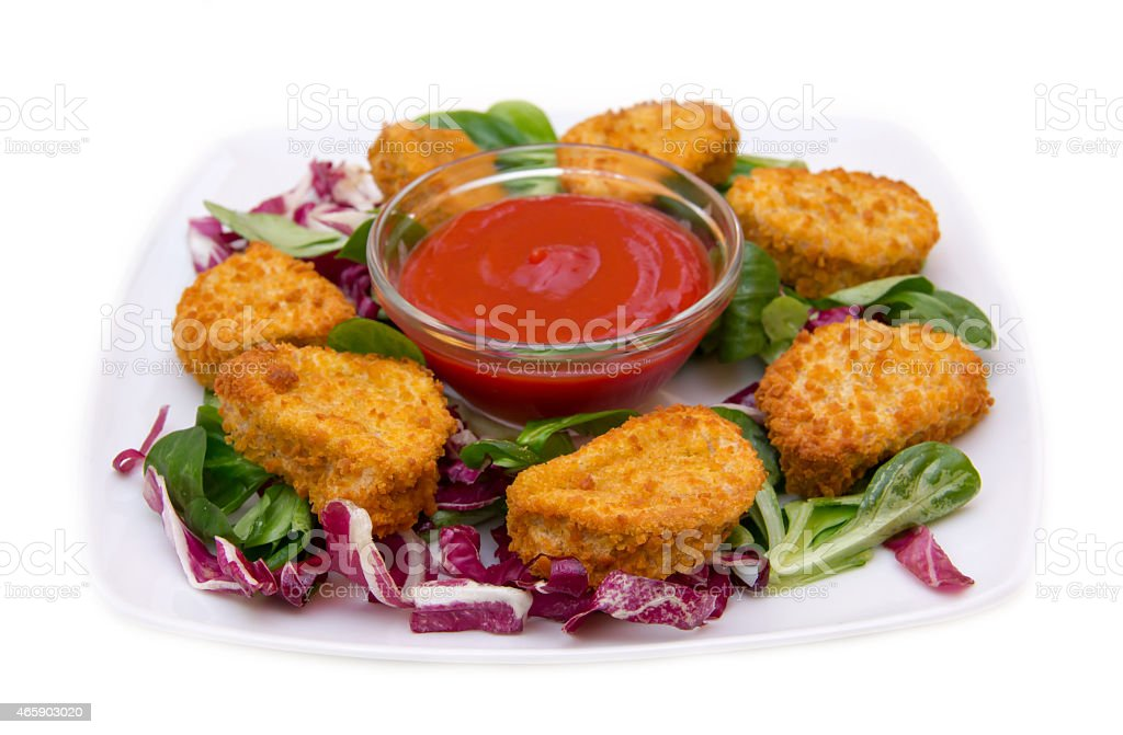 Nuggets chicken on salad stock photo
