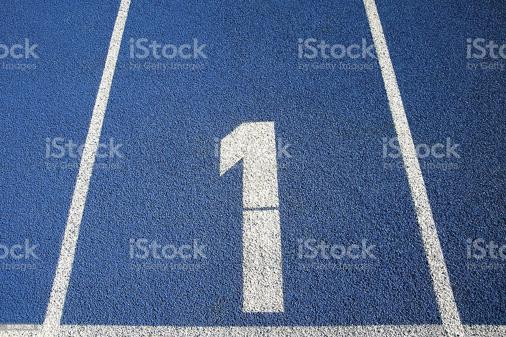 Number 1 on a running track royalty-free stock photo