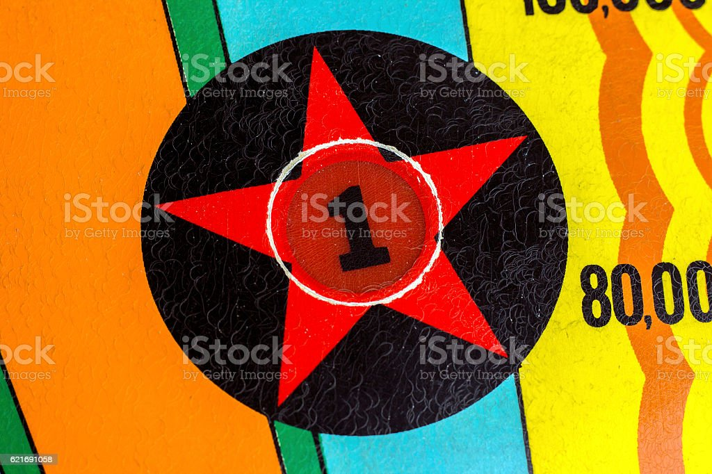Number 1 star decal light on pinball machine stock photo