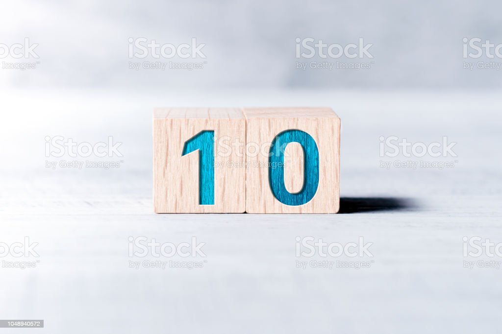 Number 10 Formed By Wooden Blocks On A White Table stock photo