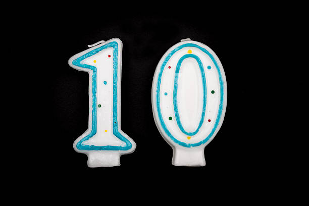number 10 in candles on black background stock photo
