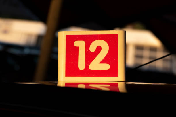 Number 12 on the hood at dusk stock photo