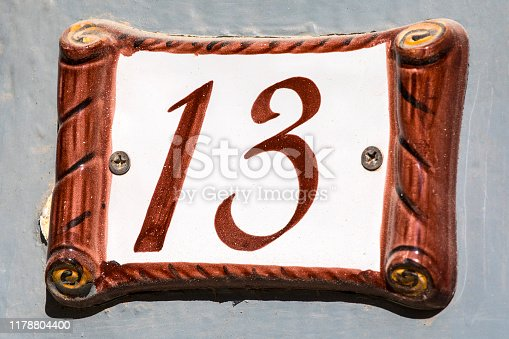 A plaque displaying the number 13.