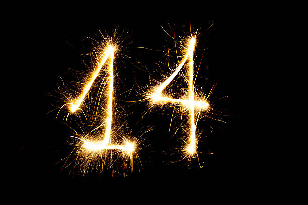 Number 14 made with sparklers stock photo