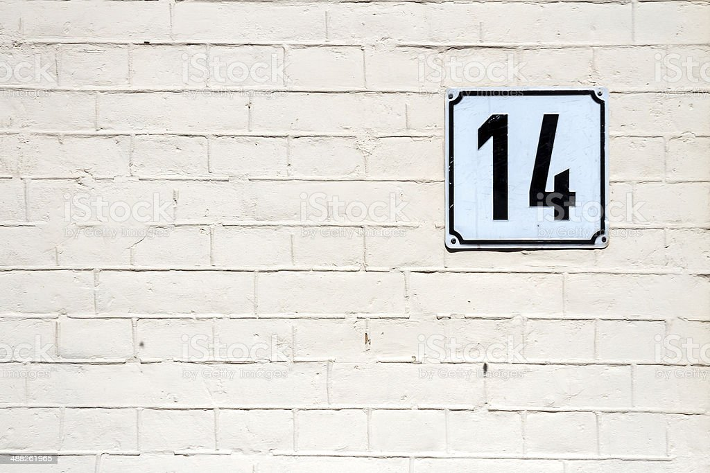 Number 14 on a wall stock photo