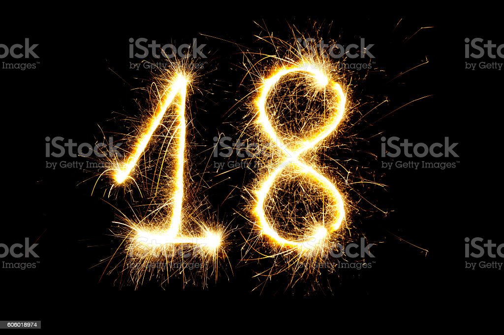 Number 18 made with sparklers stock photo