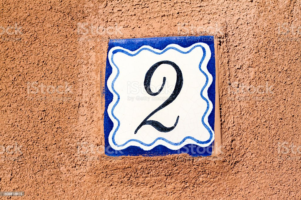 Number 2 Address Tile On Old Brown Wall stock photo