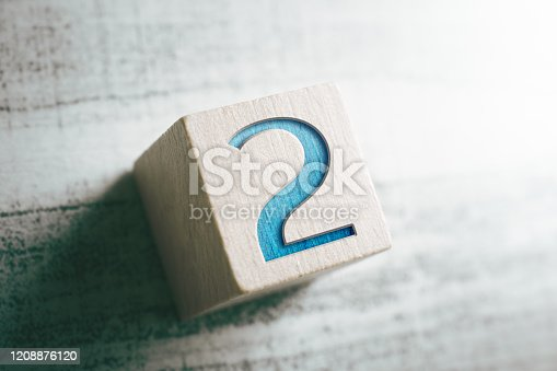 istock Number 2 On A Wooden Block On A Table 1208876120