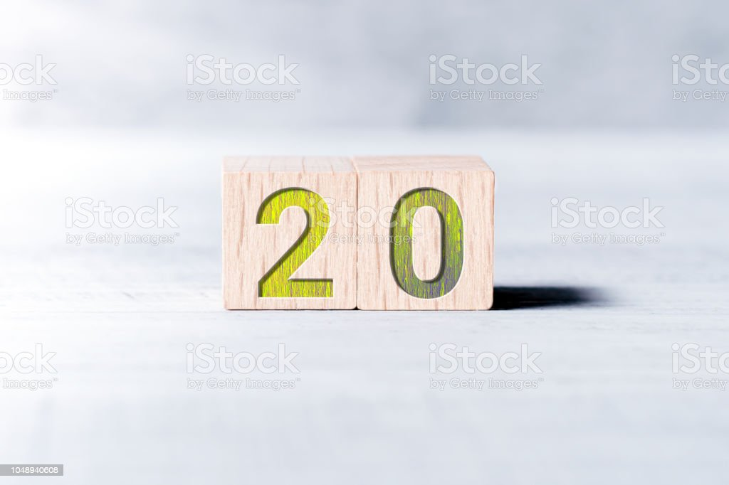 Number 20 Formed By Wooden Blocks On A White Table stock photo