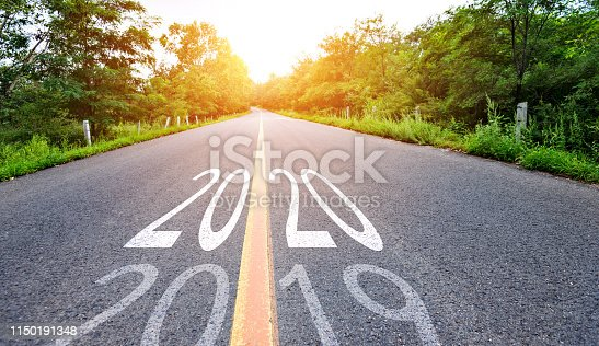 1150191246 istock photo Number 2019, 2020 on empty asphalt road 1150191348