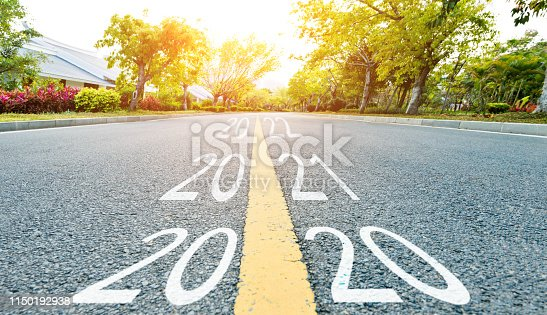 istock Number 2019, 2020, 2022 on empty road 1150192938