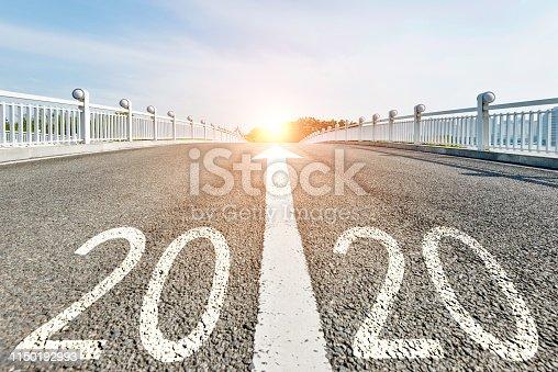 Number 2020 on asphalt pedestrian bridge.