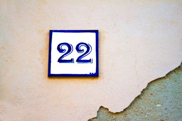 Number 22 Street Address Tile On Pale Pink Wall stock photo