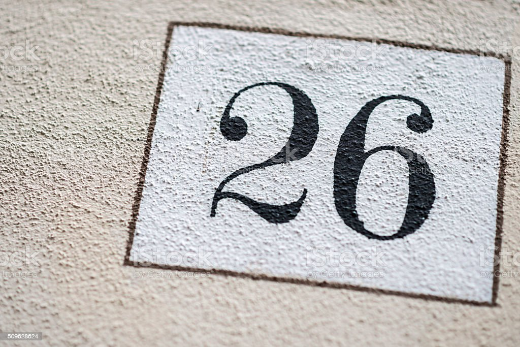 Number 26 on wall stock photo