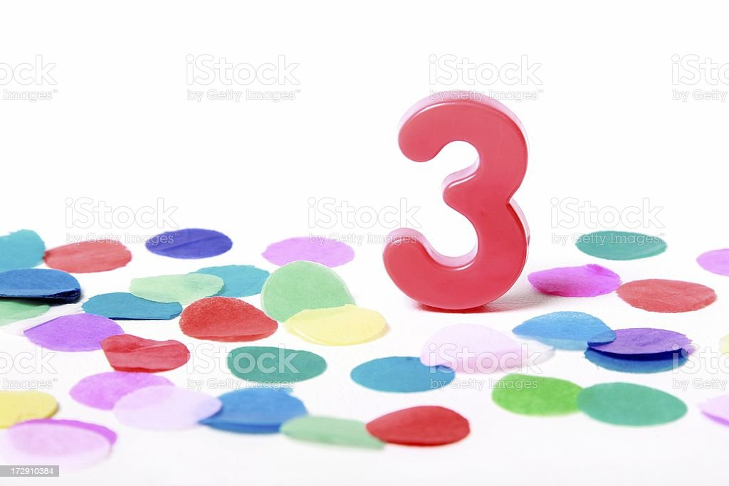 Number 3 on confetti with white background stock photo