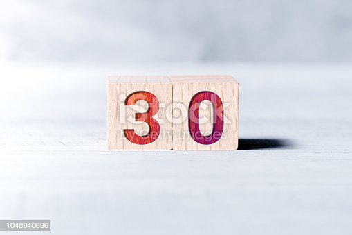 Number 30 Formed By Wooden Blocks On White Table