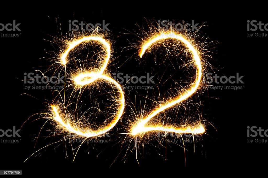 Number 32 made with sparklers stock photo