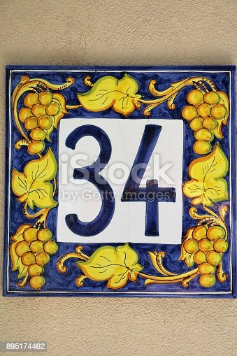 Number 34 at house wall