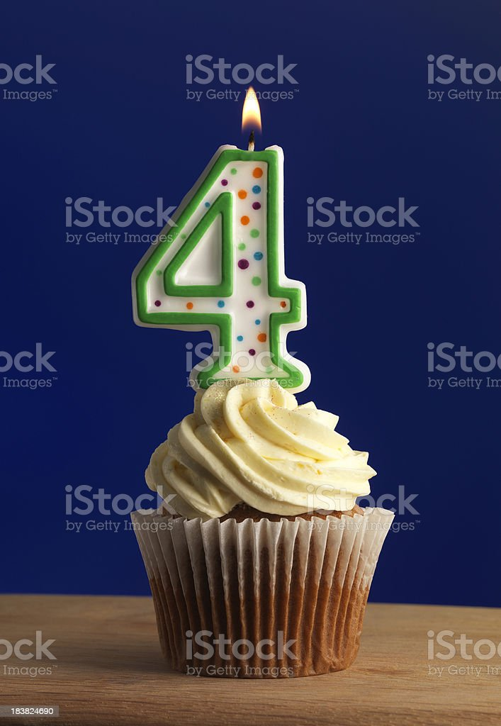 number 4 candle stock photo