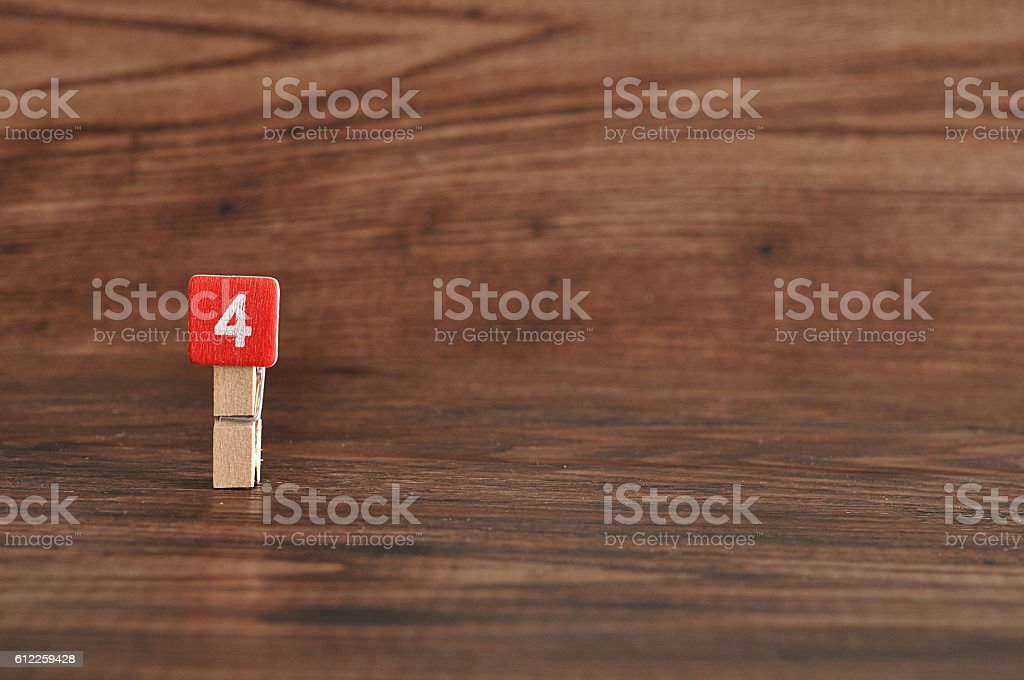Number 4 displayed on a wooden background stock photo