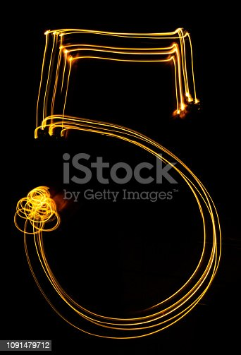 513641036istockphoto number 5, made of red tracer. burning numbers. 1091479712