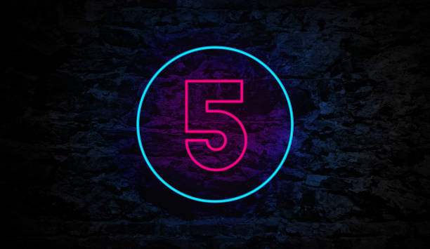 Number 5 Neon Sign on Brick Wall stock photo