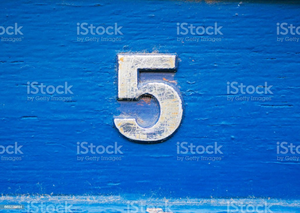 Number 5 on brick wall, background, rustic and grunge wall stock photo