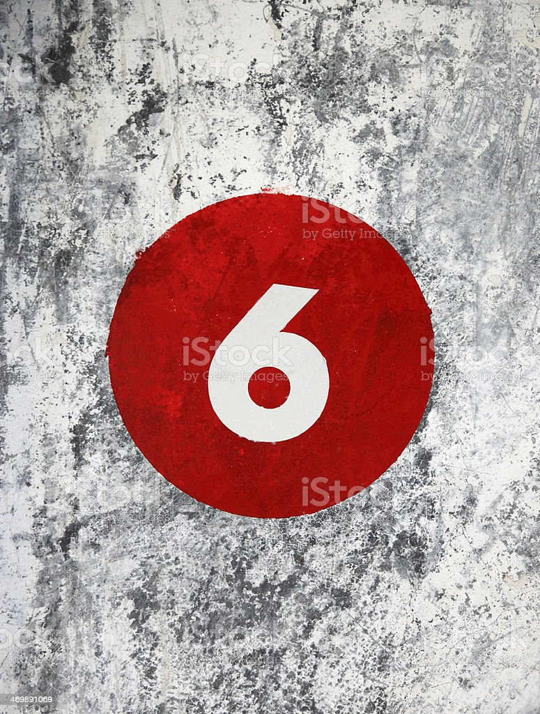 number 6 on dirty wall stock photo
