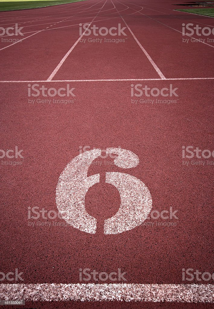 Number 6 on running track royalty-free stock photo