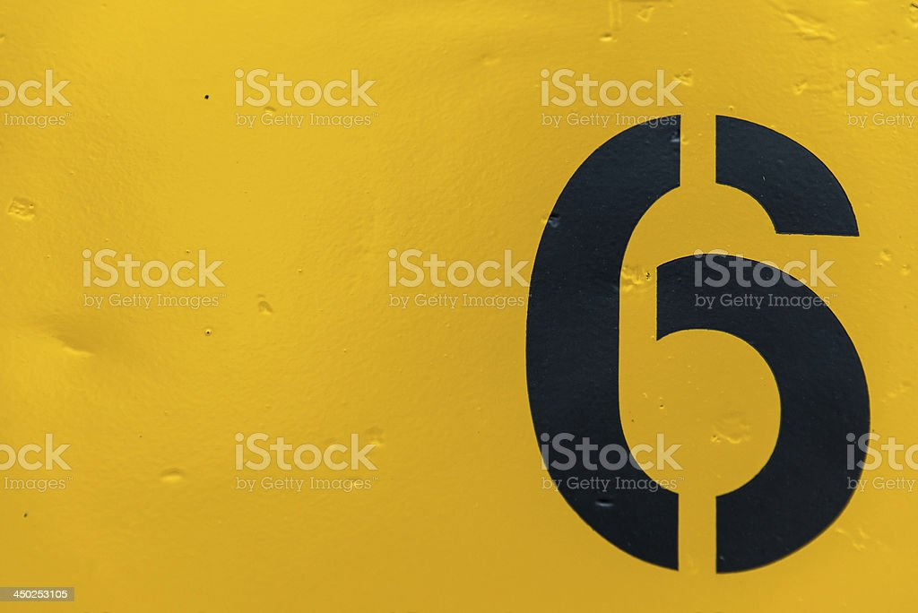 Number 6 on side of yellow metal train car stock photo