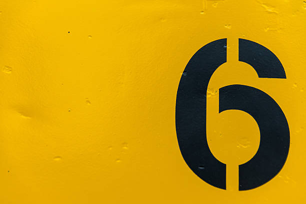 number 6 on side of yellow metal train car - number 6 stock photos and pictures