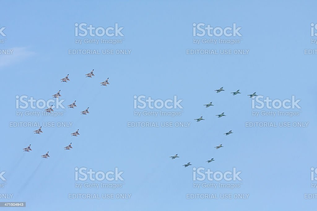 Number 65 made by MiG-29 and Su-25 aircrafts in sky royalty-free stock photo