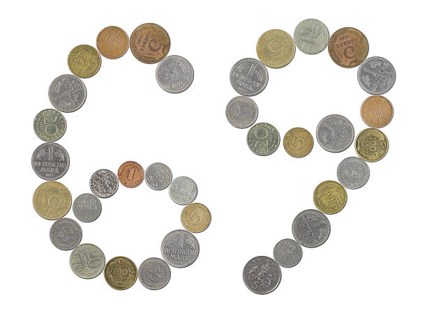 Number 69 with Old Coins stock photo