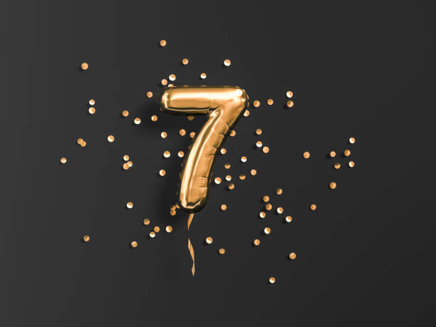 Number 7 flying foil balloon and gold confetti on black. Seven-year anniversary background Seven year birthday. Number 7 flying foil balloon and gold confetti on black. Seven-year anniversary background. 3d rendering number 7 stock pictures, royalty-free photos & images