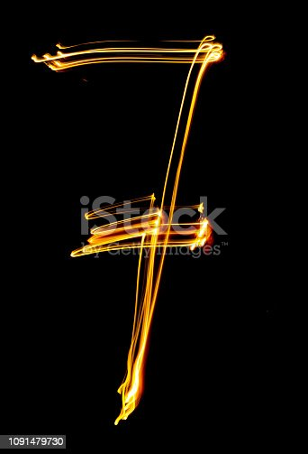 513641036istockphoto number 7, made of red tracer. burning numbers. 1091479730