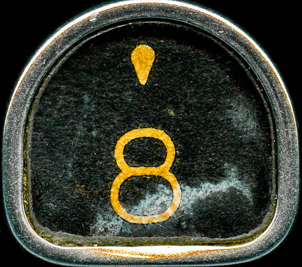 Number 8 A macro shot of a vintage typewriter key. The key features the number 8 and an apostrophe symbol in yellow. apostrophe stock pictures, royalty-free photos & images