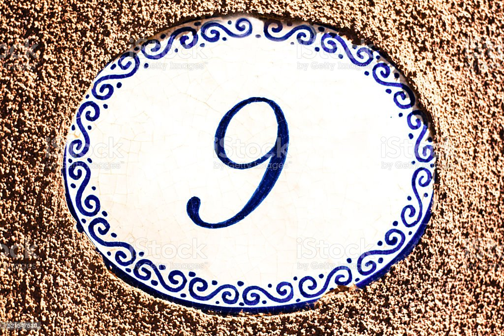 Number 9 Blue and White Ceramic Street Address Tile (Close-Up) stock photo