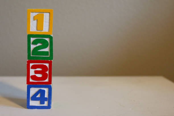Number Blocks Colorful wood number blocks of 1 2 3 4 in yellow, green, red, and blue. One Two Three Four. number 4 stock pictures, royalty-free photos & images