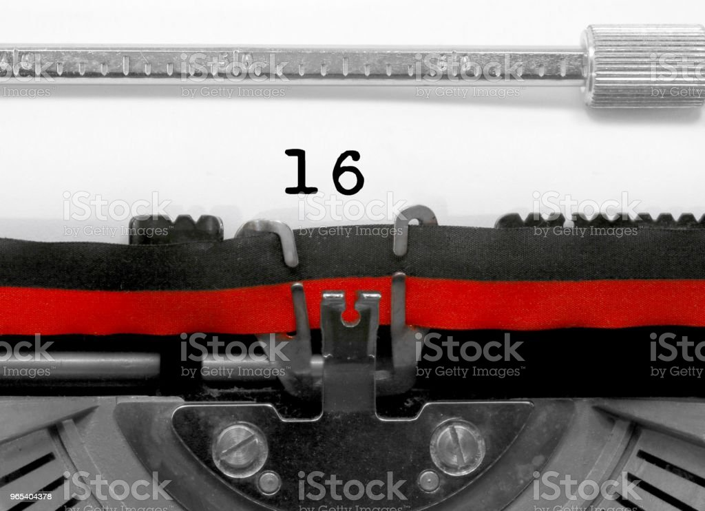 16 Number by the old typewriter on white paper royalty-free stock photo