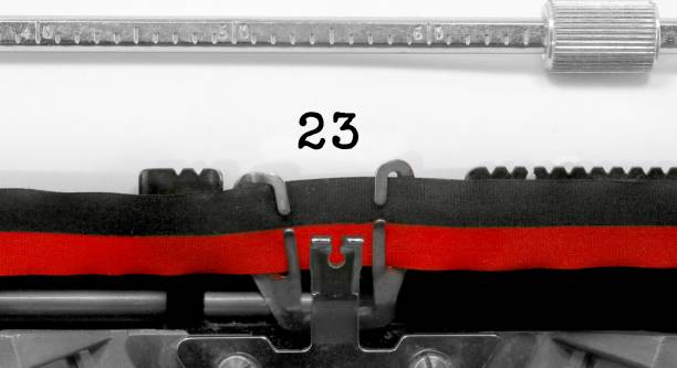 23 number by the old typewriter on white paper - number 23 stock photos and pictures