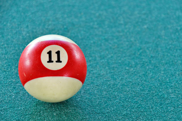 number eleven on pool ball stock photo