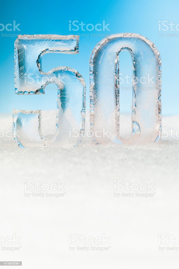 Number FIFTY ice blocks on snow background stock photo