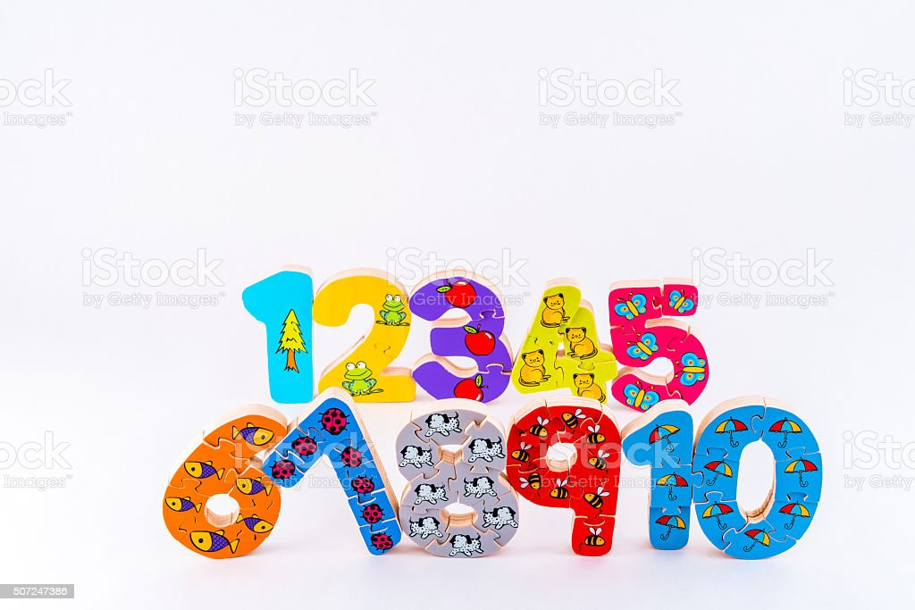Number figures one to ten wood jigsaw puzzle toy figures. stock photo