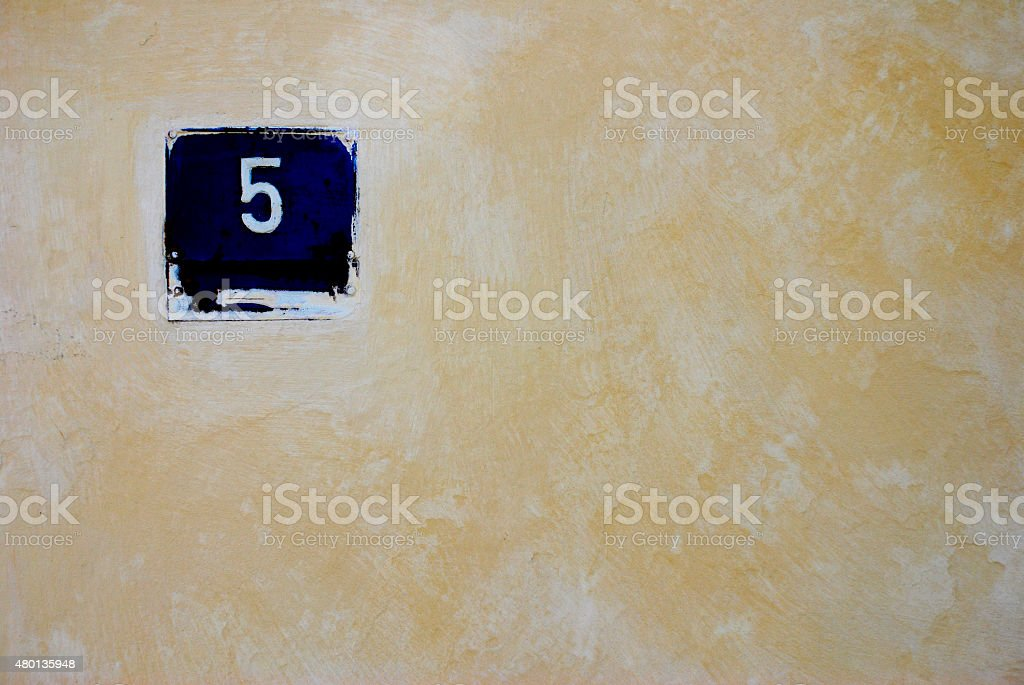 Number five on house wall stock photo
