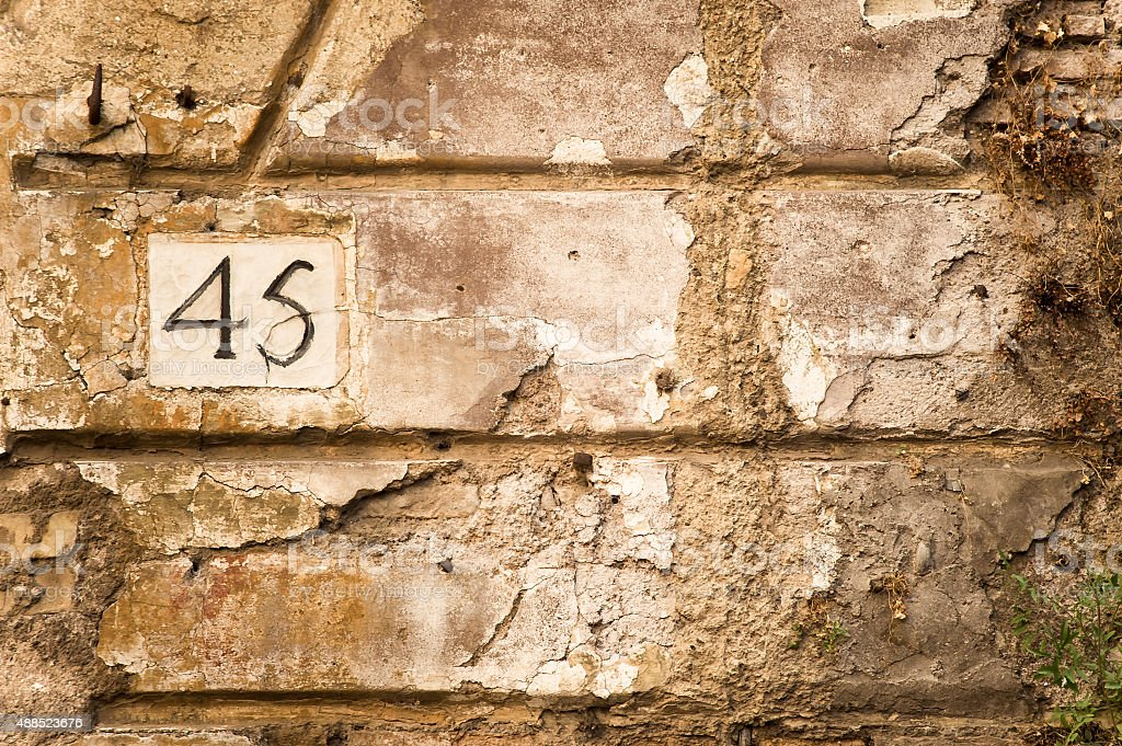 Number  forty five in the old wall stock photo