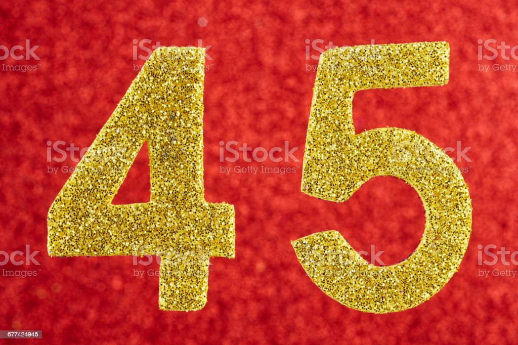 Number forty-five yellow color over a red background. Anniversary. stock photo